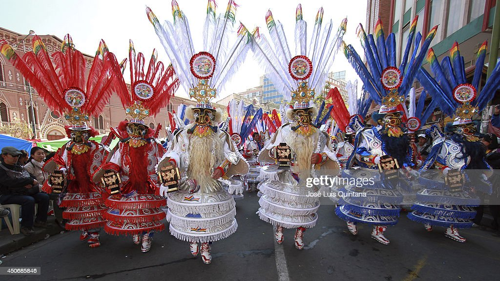 Dancers perform 'la morenada', a traditional dance of Bolivia during the religious festival of Jesus del Gran Poder on June 15, 2014 in La Paz, Bolivia. About thirty thousand people attended the event, which is a traditional folk celebration in the country.