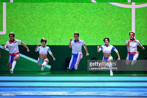 Dancers perform on stage before the Final Draw for the 2014 FIFA World Cup Brazil at Costa do Sauipe Resort on December 6 2013 in Costa do Sauipe...