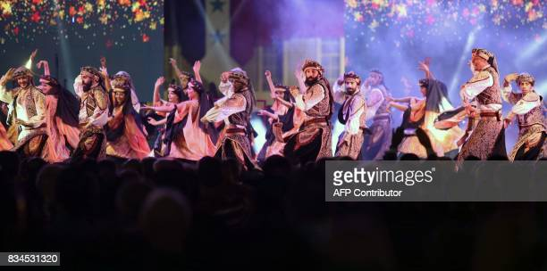 Dancers perform on stage during the opening ceremony of the Damascus International Fair late on August 17 in the Syrian capital / AFP PHOTO / Youssef...
