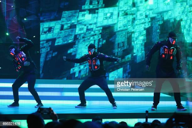 Dancers perform on stage during the Ubisoft E3 conference at the Orpheum Theater on June 12 2017 in Los Angeles California The E3 Game Conference...