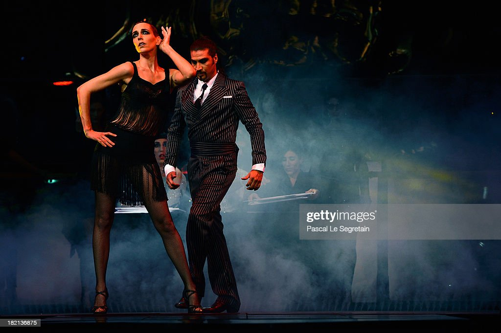 Dancers perform on the runway during Jean Paul Gaultier show as part of the Paris Fashion Week Womenswear Spring/Summer 2014 at Le Paradis Latin on September 28, 2013 in Paris, France.