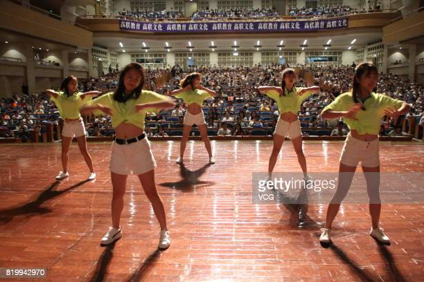 Dancers perform on the stage for about 2000 college students who take part in a tutorial and review session for postgraduate entrance examination at...