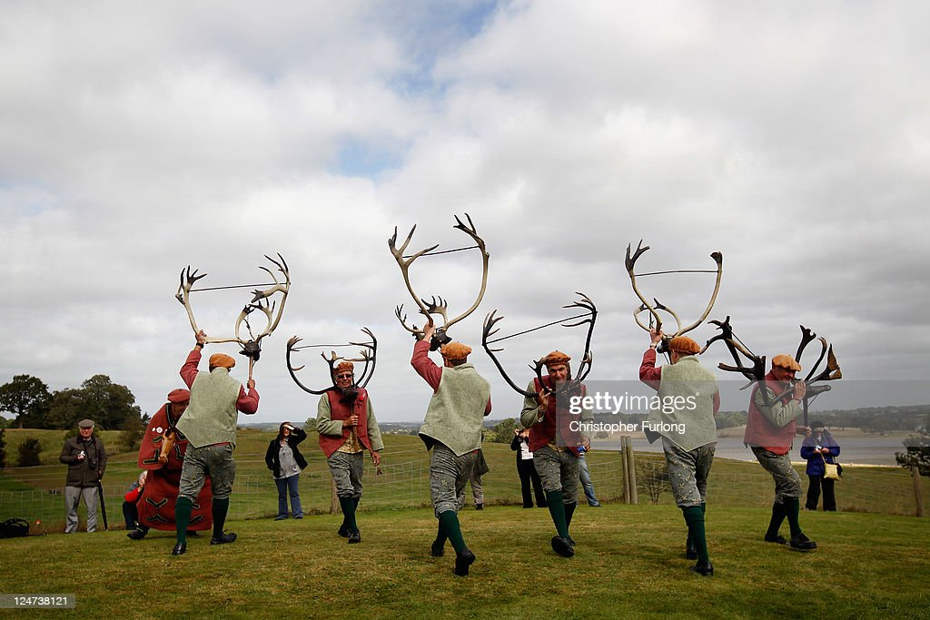 Dancers perform the Abbots Bromley Horn Dance on September 12, 2011 in Abbots Bromley, United Kingdom. The dance comprising of six Deer-men, a Fool, Hobby Horse, Bowman and Maid Marian start in the early morning at the village church. A melodian player accompanies the dancers as they parade around the parish holding Reindeer antlers above their heads. The traditional Wakes Monday dance is believed to be the oldest folk dance in Britain and some of the antlers have been carbon dated to be over 1000 years old.
