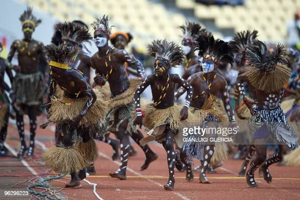 Dancers perform traditional dances ahead of the final football match between Egypt and Ghana of the African Cup of Nations CAN2010 at the November 11...