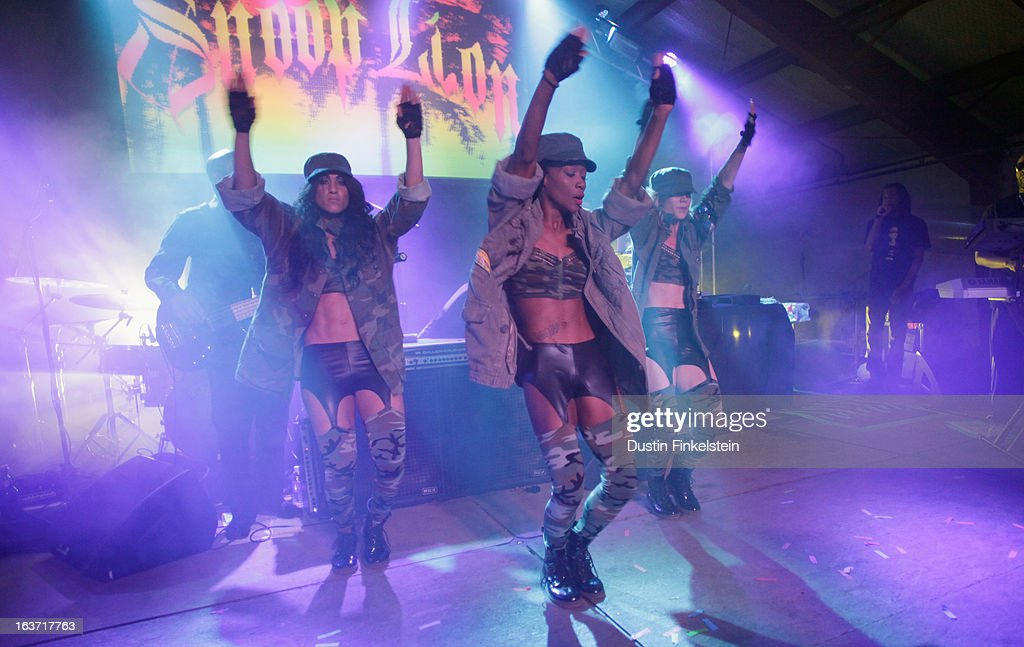 Dancers perform with recording artist Snoop Dogg aka Snoop Lion at Lion Fest during the 2013 SXSW Music, Film + Interactive Festival at Viceland on March 14, 2013 in Austin, Texas.