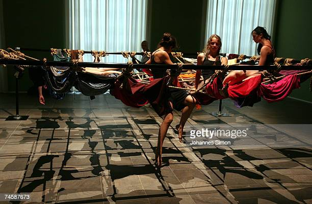 Dancers perform within the installation 'Floor Of The Forest' of US artist Trisha Brown during a media preview of Documenta 12 on June 13 2007 in...