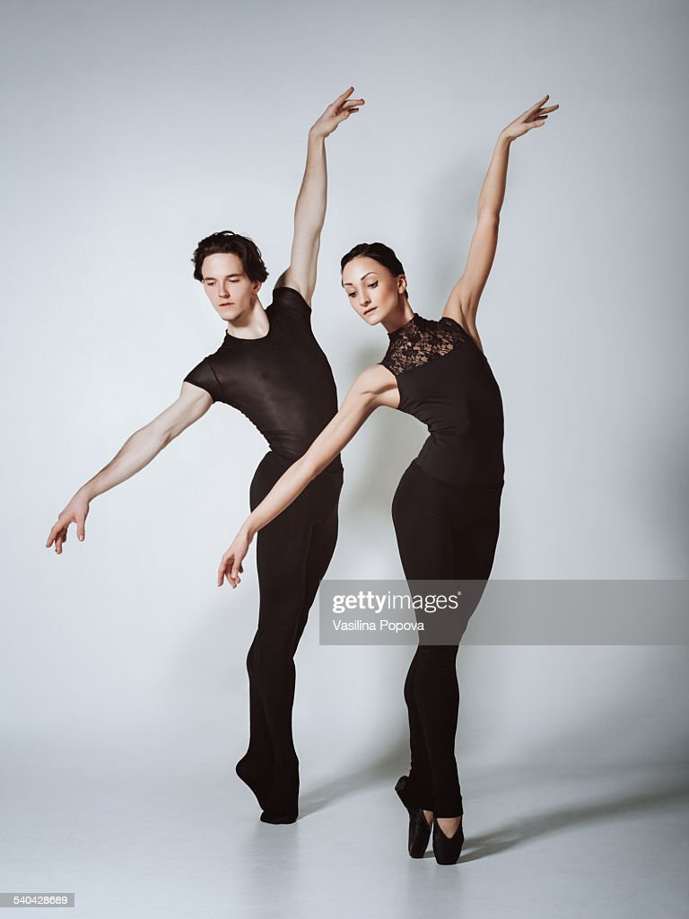 Dancers Performing Ballet Pose En Pointe Stock Photo ...