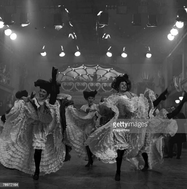 Dancers performing the Can Can dance during the shooting of the film 'Moulin Rouge' 1952