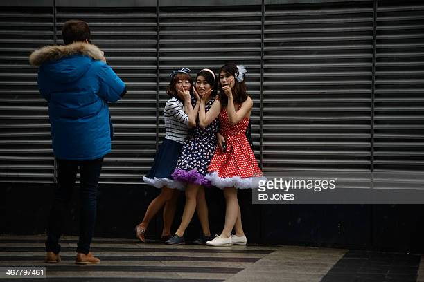 Dancers pose for a photo as they prepare to take part in a dance festival in the Gangnam district of Seoul on February 8 2014 Some 700 dancers...