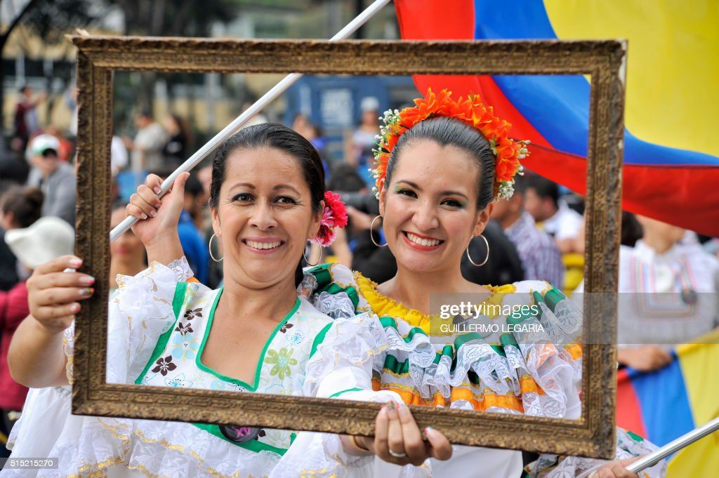 Dancers pose for a picture during the inaugural parade of the 15th Ibero-American Theatre Festival in Bogota on March 12, 2016. The biennial festival's first edition took place in 1988 and is considered the largest theatre festival in the world.