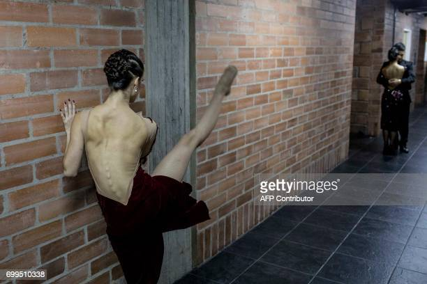 TOPSHOT Dancers prepare before competing in the Tango Dancing Tournament during the XI International Tango Festival in Medellin Colombia on June 21...