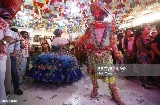 Dancers prepare to perform during a traditional Festas Juninas party at the Salgueiro samba school on June 18 2017 in Rio de Janeiro Brazil Rio's new...