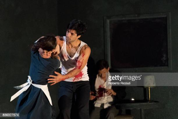 Dancers Rena Narumi Ceasar Faria Fernandes and Roger Van der Poel of Netherland Dans Theatre performs on stage 'The missing door' by choreographer...