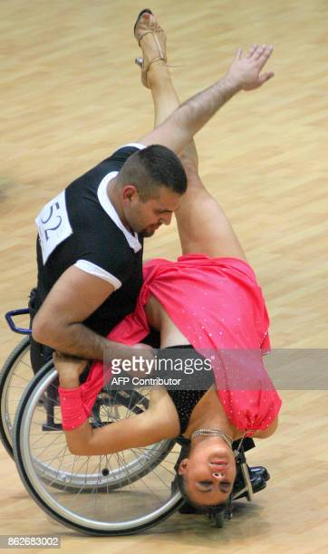 Dancers representing Ukraine compete in wheelchairs during the Eurasia Cup 2005 wheelchair dancing tournament in St Petersburg 20 May 2005...