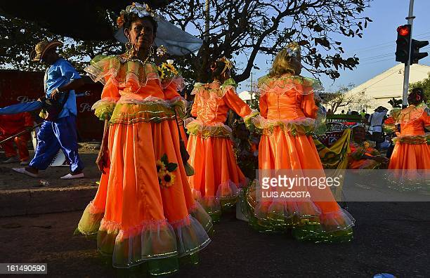 Dancers rest after taking part in the third day of carnival in Barranquilla Colombia on February 11 2013 Barranquilla's Carnival a tradition created...