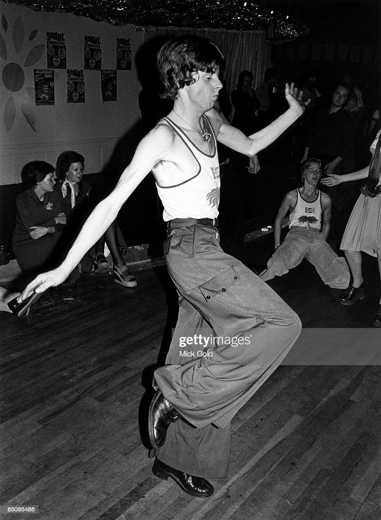 Dancers showing off the characteristic fashions and energetic dance moves of Northern Soul on the dance floor at an 'all-nighter', in October 1975 in the United Kingdom.