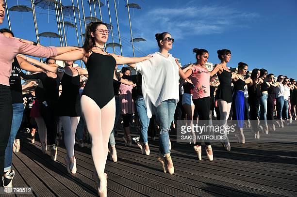 Dancers stand together en pointe in Thessaloniki on October 1 during a Guinness World Record attempt 429 ballet dancers from across North Greece...
