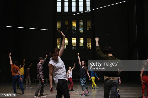 Dancers take part in a dress rehearsal of 'If Tate Modern was Musee de la Danse' at Tate Modern on May 14 2015 in London England The performance is...