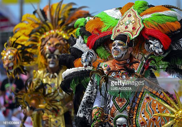 Dancers take part in the second day of carnival parade in Barranquilla Colombia on February 10 2013 Barranquilla's Carnival a tradition created by...