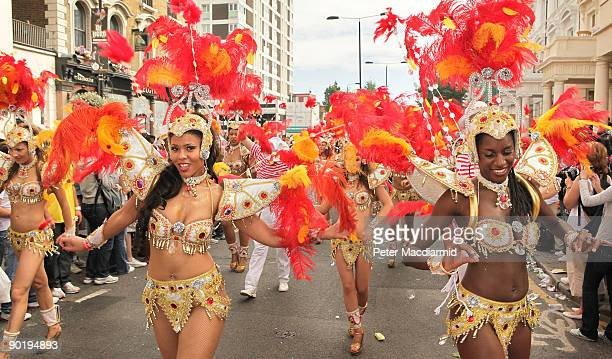 Dancers take part in the street procession at the Notting Hill Carnival on August 31 2009 in London England Hundreds of thousands of people are...