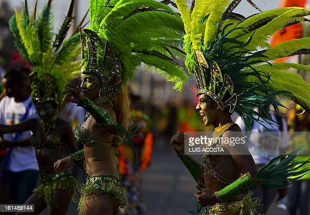 Dancers take part in the third day of carnival in Barranquilla Colombia on February 11 2013 Barranquilla's Carnival a tradition created by locals at...