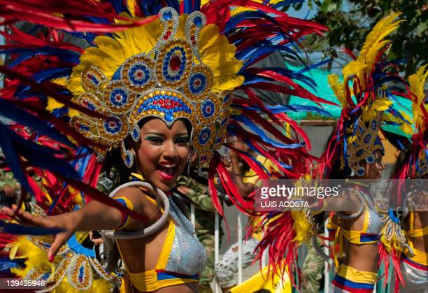 Dancers take part in the third day of carnival parade in Barranquilla Colombia on February 20 2012 Barranquilla's carnival a tradition cretaed by...