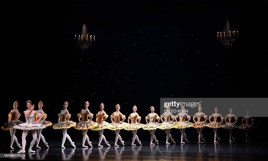 Dancers take to the stage during a full-dress rehearsal of the Australian Ballet's performance of La Sylphide at the Opera House in Sydney on November 6, 2013. The romantic ballet from 1836 will run at the Opera House from November 7 to 25. AFP PHOTO / Saeed Khan