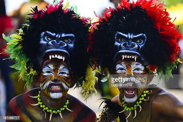 Dancers takes part in the third day of carnival in Barranquilla Colombia on February 11 2013 Barranquilla's Carnival a tradition created by locals at...