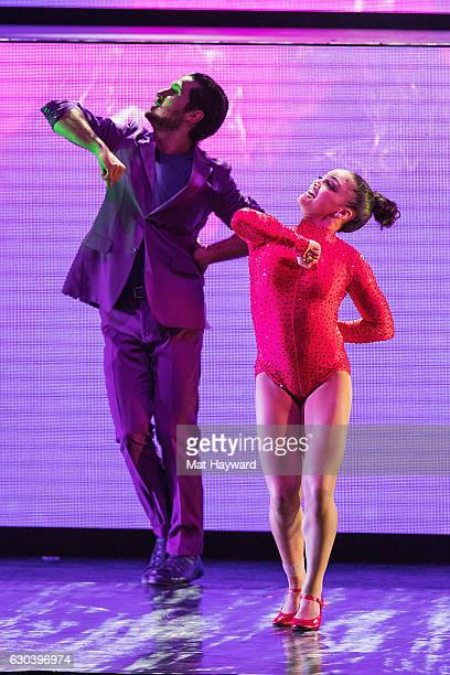 Dancers Valentin Chmerkovskiy and Olympic Gold Medal winning gymnast Laurie Hernandez perform on stage during the 'Dancing With The Stars' Live Tour...