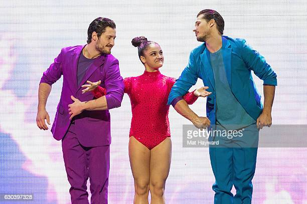 Dancers Valentin Chmerkovskiy Laurie Hernandez and Gleb Savchenko perform during the 'Dancing With The Stars' Live Tour at Paramount Theatre on...