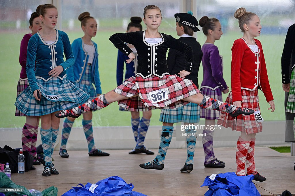 Dancers warm up before competing at the Cowal Highland Gathering on August 30, 2013 in Dunoon, Scotland. First held in 1894, the Cowal Games are held over three days and are one of the largest in the world attracting competitors from Canada, USA, South Africa, Australia and New Zealand.