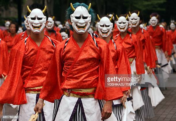 Dancers wearing masks and kimonos perform in the streets at the 'Super Yosakoi 2015' dance festival in Tokyo on August 30 2015 One hundred dance...