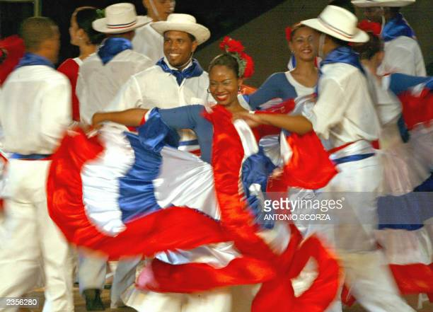 Dancers wearing typical dresses perform during the opening ceremony of the XIV Pan American Games at the Olympic Stadium Juan Pablo Duarte in Santo...