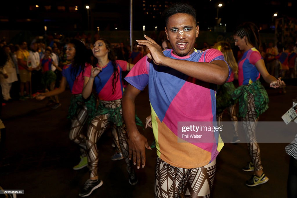 Dancers welcome the Great Britain team during the teams official welcome and flag raising ceremony in the athletes village ahead of the 2016 Rio...