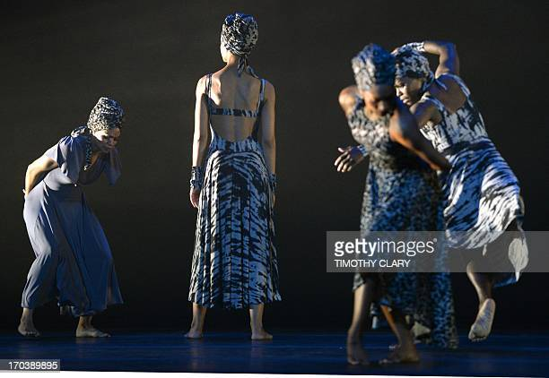 Dancers with the Alvin Ailey American Dance Theater perform part of 'Four Corners' during a dress rehearsal June 12 2013 as the Alvin Ailey American...