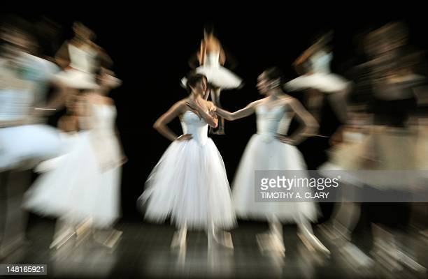 Dancers with the Paris Opera Ballet wait to perform a scene from 'Suite en Blanc' during a dress rehearsal July 11 2012 before opening night at the...