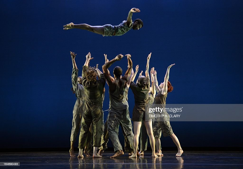 Dancers with the The Bill T. Jones/Arnie Zane Dance Company perform a scene from 'D-Man in the Waters' during a dress rehearsal before opening night at the Joyce Theatre March 26, 2013. The Bill T. Jones/Arnie Zane Dance Company commemorates thirty years of creativity and impact with a two-week engagement.