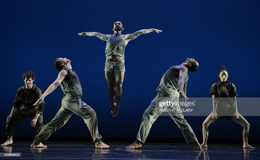 Dancers with the The Bill T. Jones/Arnie Zane Dance Company perform a scene from 'D-Man in the Waters' during a dress rehearsal before opening night at the Joyce Theatre March 26, 2013. The Bill T. Jones/Arnie Zane Dance Company commemorates thirty years of creativity and impact with a two-week engagement. AFP PHOTO / TIMOTHY A. CLARY