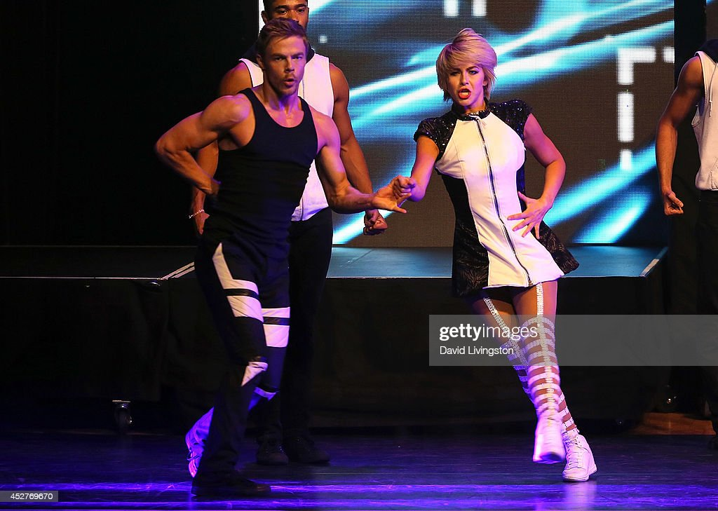 Dancers/TV personalities <a gi-track='captionPersonalityLinkClicked' href=/galleries/search?phrase=Derek+Hough&family=editorial&specificpeople=4532214 ng-click='$event.stopPropagation()'>Derek Hough</a> (L) and <a gi-track='captionPersonalityLinkClicked' href=/galleries/search?phrase=Julianne+Hough&family=editorial&specificpeople=4237560 ng-click='$event.stopPropagation()'>Julianne Hough</a> perform on stage during the Move Live on Tour production at the Orpheum Theatre on July 26, 2014 in Los Angeles, California.
