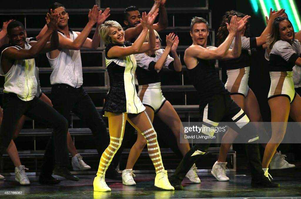 Dancers/TV personalities <a gi-track='captionPersonalityLinkClicked' href=/galleries/search?phrase=Julianne+Hough&family=editorial&specificpeople=4237560 ng-click='$event.stopPropagation()'>Julianne Hough</a> (L, foreground) and <a gi-track='captionPersonalityLinkClicked' href=/galleries/search?phrase=Derek+Hough&family=editorial&specificpeople=4532214 ng-click='$event.stopPropagation()'>Derek Hough</a> (R, foreground) perform on stage during the Move Live on Tour production at the Orpheum Theatre on July 26, 2014 in Los Angeles, California.