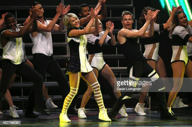 Dancers/TV personalities Julianne Hough and Derek Hough perform on stage during the Move Live on Tour production at the Orpheum Theatre on July 26...