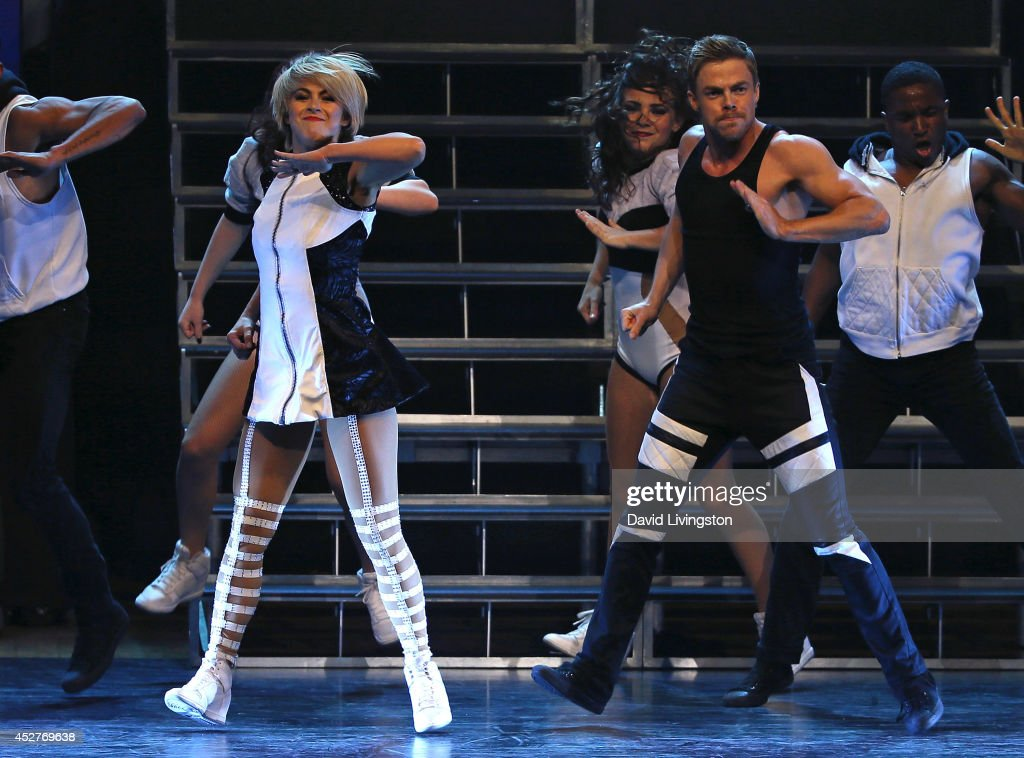 Dancers/TV personalities <a gi-track='captionPersonalityLinkClicked' href=/galleries/search?phrase=Julianne+Hough&family=editorial&specificpeople=4237560 ng-click='$event.stopPropagation()'>Julianne Hough</a> (L) and <a gi-track='captionPersonalityLinkClicked' href=/galleries/search?phrase=Derek+Hough&family=editorial&specificpeople=4532214 ng-click='$event.stopPropagation()'>Derek Hough</a> perform on stage during the Move Live on Tour production at the Orpheum Theatre on July 26, 2014 in Los Angeles, California.