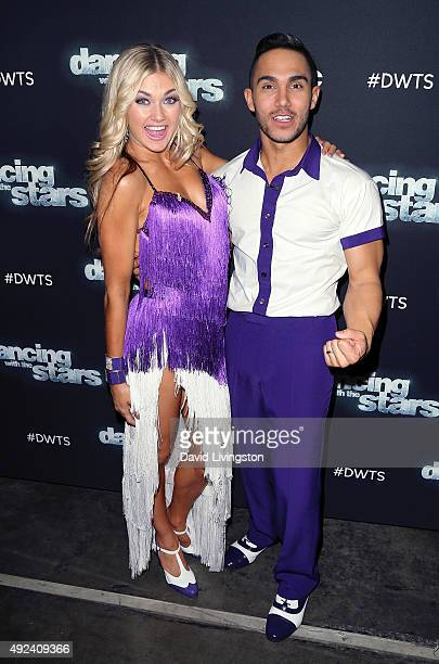 Dancer/TV personality Lindsay Arnold and actor Carlos PenaVega attend 'Dancing with the Stars' Season 21 at CBS Televison City on October 12 2015 in...