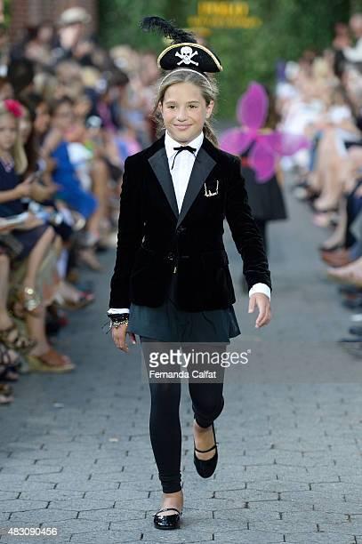 Dancer/tv personality Mackenzie Ziegler walks at Ralph Lauren Children's Fashion Show at Central Park Zoo on August 5 2015 in New York City