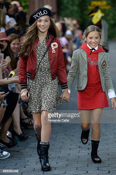 Dancer/tv personality Maddie Ziegler and Mackenzie Ziegler walk at Ralph Lauren Children's Fashion Show at Central Park Zoo on August 5 2015 in New...