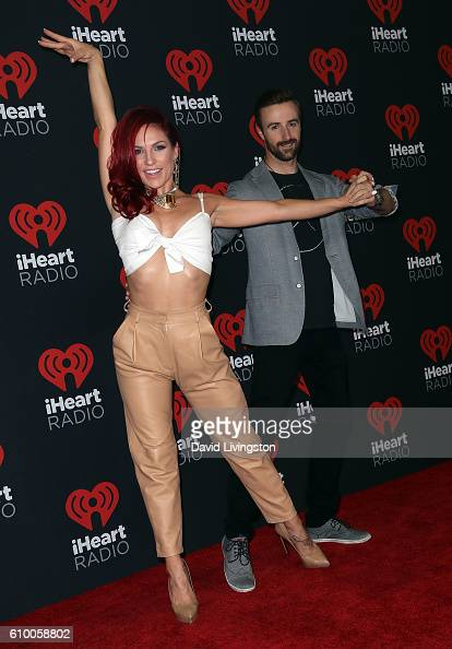 Dancer/TV personality Sharna Burgess and race car driver James Hinchcliffe attend the 2016 iHeartRadio Music Festival Night 1 at TMobile Arena on...