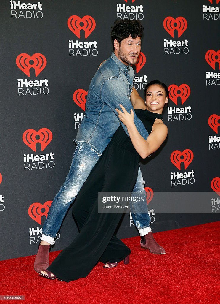 Dancer/TV personality Val Chmerkovskiy (L) and Olympic gymnast Laurie Hernandez attend the 2016 iHeartRadio Music Festival at T-Mobile Arena on September 23, 2016 in Las Vegas, Nevada.
