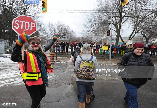 TORONTO ON DECEMBER 9 Dancing Crossing Guard Kathleen Byers is all smiles as kids from nearby school rally for her because she was told by police...