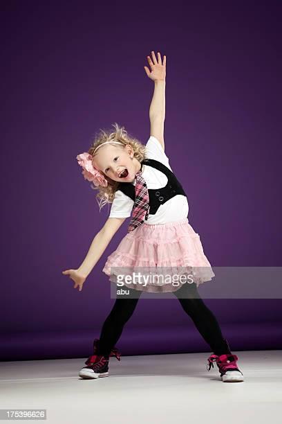 Dancing girl in funny pose