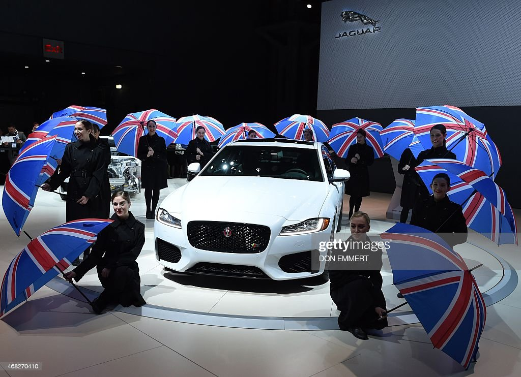 Dancing girls at the unveiling of the Jaguar media conference April 1 2015 during the New York Auto Show at the Jacob Javits Center in New York AFP...